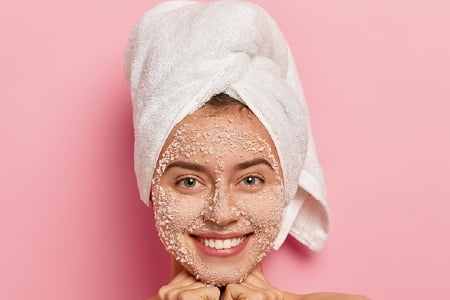Image of a girl with Facial Scrub and Pink Background